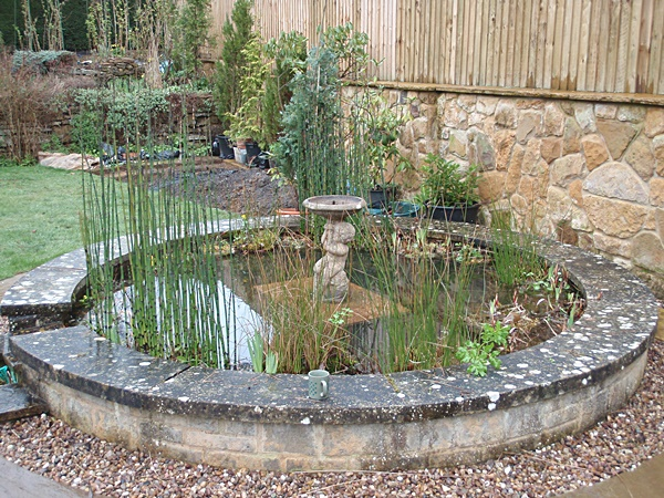 Raised pond gallery garden pond specialists in the for Stone koi pond